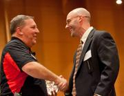 James Canham, (right) director of pharmacy operations at Express Scripts, accepts the award for past winner 300 to 999 employees.