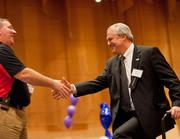 Mike Prescott, (right) president of U.S. Bank, accepts the award for first-time participant 1,000 employees or more.