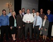 BSI Engineering staff celebrate their hard work with a 2011 Small Business Excellence Award.