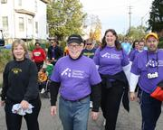 Catholic Health Partners CEO Michael Connelly, center, out walking the walk with staffers.