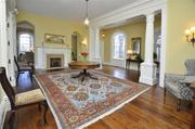 The grand foyer of Carneal House has antique hardwood floors.