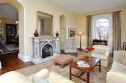 The formal living room of Carneal House has a fireplace from the 1800s that is believed to be imported from Italy.
