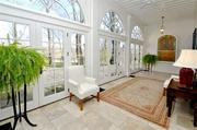 The restored solarium was the original sleeping porch in the 1800s.The limestone floor is now heated.