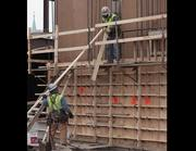 These workers are setting up concrete forms before the material can be poured.