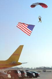 A skydiver dropped in as the crowd sang the National Anthem to begin the groundbreaking ceremonies.