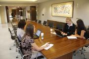 A group of First Financial employees meet in one of the bank's conference rooms.
