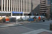 The eastern portion of Fountain Square is under repair.