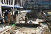 Workers are trying to repair Fountain Square, which is leaking water into Fifth Third Tower.