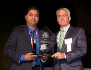 Kevin Atwell, general counsel of performance automotive presented the Fast55 award for fastest growing company $5.1 – $10 million to Gensuite LLC represented by R. Mukund, Chief Executive Officer and Founder
