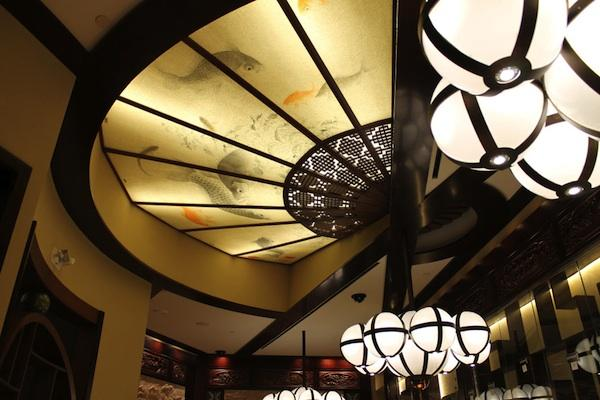The ceiling of the Asian Gaming Room at Horseshoe Casino Cincinnati is a giant hand-painted Chinese paper fan.