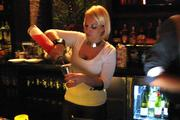 A bartender at Igby's pours a drink. The bar will have a cocktail menu created by mixologist Brian Van Flandern.