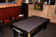 Igby's has a pool table to help keep guests entertained while enjoying a drink.