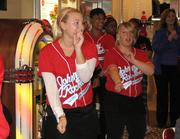 Johnny Rockets' servers performing a dance for patrons.