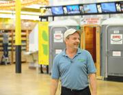 Phill Adams, director of development, Jungle Jim's. Note theaward-winning bathrooms in the background.