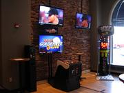 What sports bar would be complete with out the newest version of Golden Tee Live and Boxer Glove?