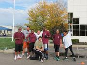 Megen employees work out at the office with a trainer.