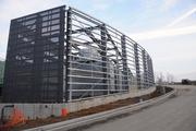 These are enclosures for A/C cooling towers, so as not to be unsightly to patients looking out their windows. Workers are with Merit Erectors.