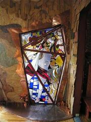 Another stained glass window, with irregular shapes and patterns.
