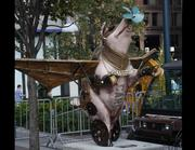 """Name: """"Professor Pignassus and His Cinsational Flying Machine""""Location: Fountain SquareDesigner: Jaclin Hastings, Lizz Godfroy & David RiceSponsor: School Outfitters"""