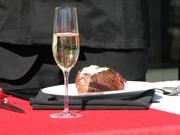 """A glass of champagne and a Ruth's Chris signature steak at the Oct. 11 """"steak cutting"""" ceremony that replaced the traditional ribbon cutting."""