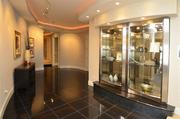 The entrance gallery has built-in cabinetry for displaying art and glassware.