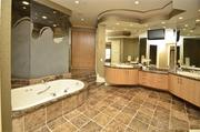 The master bath has a jetted tub and two walk-in closets.