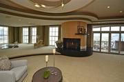 A black granite fireplace is in the center of wall-to-wall windows that show off the Cincinnati skyline.