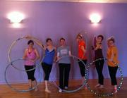 Employees of SparkPeople staying fit and having fun with hula hoops.