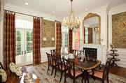 The dining room at 2 Taft Road Lane has two French doors and a fireplace.
