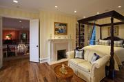 The master bedroom at 2 Taft Road Lane has plenty of space and a fireplace.