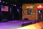 The venue includes a stage for national and local bands and entertainers.
