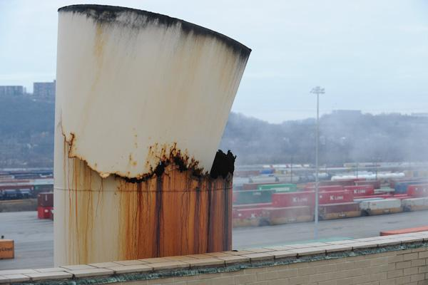 This boiler stack at Union Terminal has rusted through and is tipping over into itself.