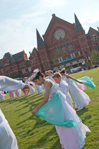For this year's Courier 250 publication cover, we asked Mark Bowen to capture some of the World Choir Games performers at an event in the new Washington Park, near Music Hall. Shown here are members of a Russian choir who participated in the summer games.