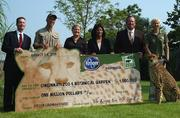 At the check presentation ceremony were from, left to right, John Boes of Pepsi; Cincinnati Zoo Director Thane Maynard; Kroger Co.'s Lynn Marmer, Kroger Co.'s Sukanya Madlinger, Pepsi's Ken Gronholm, and the zoo's Alicia Sampson with Sarah the Cheetah