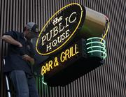 After   The bar's new sign is installed.