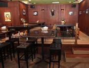 After   The updated look of The Public House, with new tables, chairs and decorations.