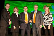 Representatives from Intelligrated receive the 2012 Growth Award from the Cincinnati USA Partnership.