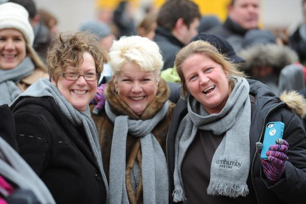 """DunnhumbyUSA's Tina Dewald, administrative assistant; Susan Vinson, executive assistant; and Jeni Thompson, receptionist, all donned their """"Dunnhumby Centre"""" scarves at the groundbreaking."""