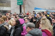 """Hundreds of """"Dunnhumbians,"""" most of them wearing their logo-scarves, braved the freezing temperatures to attend the groundbreaking at Fifth and Race streets."""