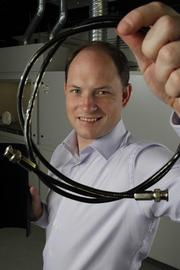 General Nano President Joe Sprengard holds a satellite cable shielded in