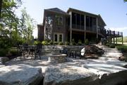 The outdoor space at the Chelsea has a built-in firepit and plenty of seating.