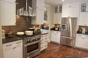 The gourmet kitchen, with stainless steel appliances, in the Potterhill Homes home.