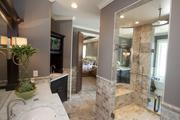 The Dennison by Walker Homes has a master bathroom with a shower built in the middle of the room.