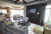 A spacious family room flows into the kitchen at the Dennison by Walker Homes.