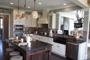 The Wheatland by Fischer Homes kitchen has a farm sink.