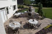 A stone pizza oven on the patio of the Wheatland by Fischer Homes.