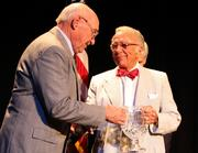 """John Goering, founder of the Goering Center for Family and Private Business, left, presents the first Greater Cincinnati Family Business Hall of Fame Award to LaRosa's Founder, Chairman Emeritus, Donald """"Buddy"""" LaRosa."""