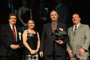 From left, Carolyn Pione Micheli, communications director for CincyTech; award winner Mike Disimile of ESI Inc.; and Courier Publisher Jamie Smith.