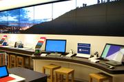 Flat-screen TVs line the wall above Microsoft products at the new Kenwood Towne Centre store.