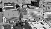 A 2010 rendering of the 610-space garage (left), was criticized for looking like a jail.